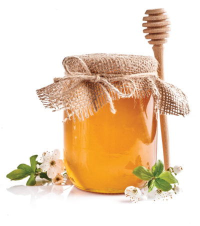 Jar of honey with flowers